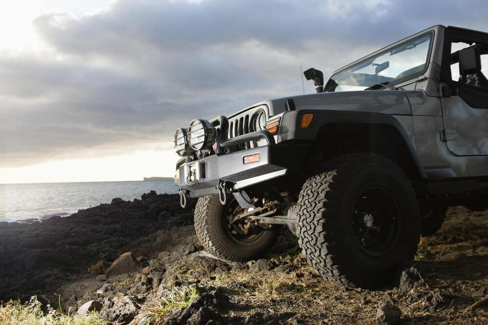 Off-road jeep on rocky beach