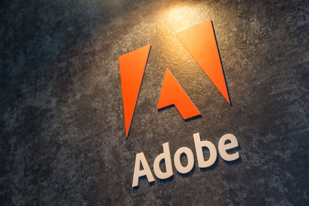 Adobe logo on dark gray wall
