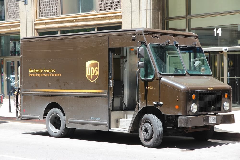 A UPS delivery truck parked in front of a building
