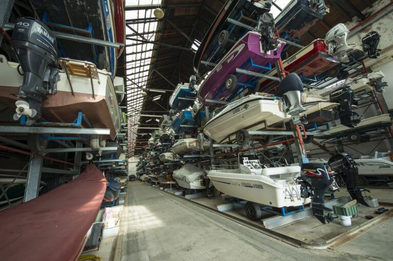 Many small boats in an indoor boat storage facility
