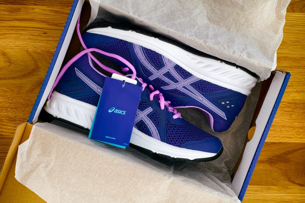 New blue and purple running shoes in the box