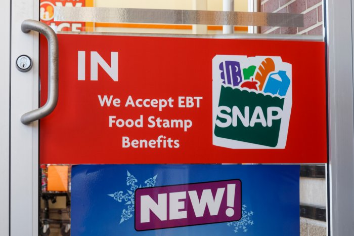 EBT acceptance sign on the door of a store