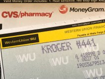 Close up of MoneyGram and Western Union money orders