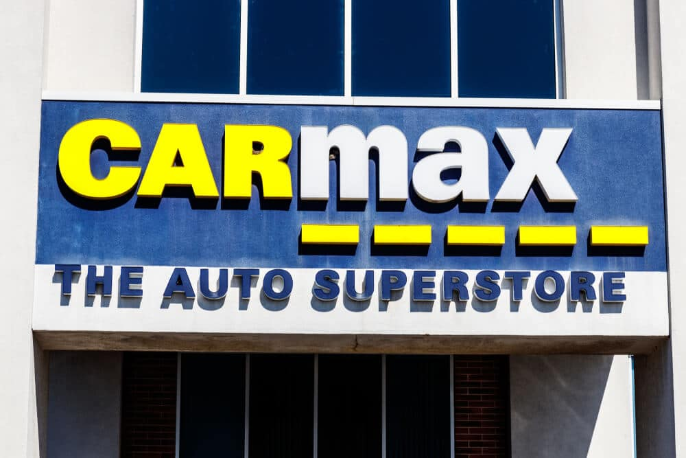 Sign on the outside of a CarMax store