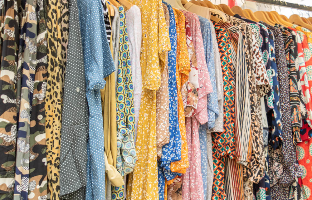 Rack filled with clothes at a consigment shop that pays cash upfront