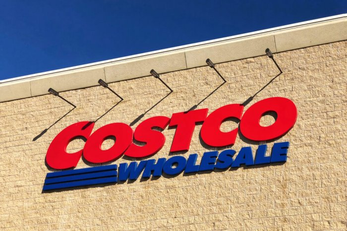 A Costco Wholesale sign on the exterior of a store building