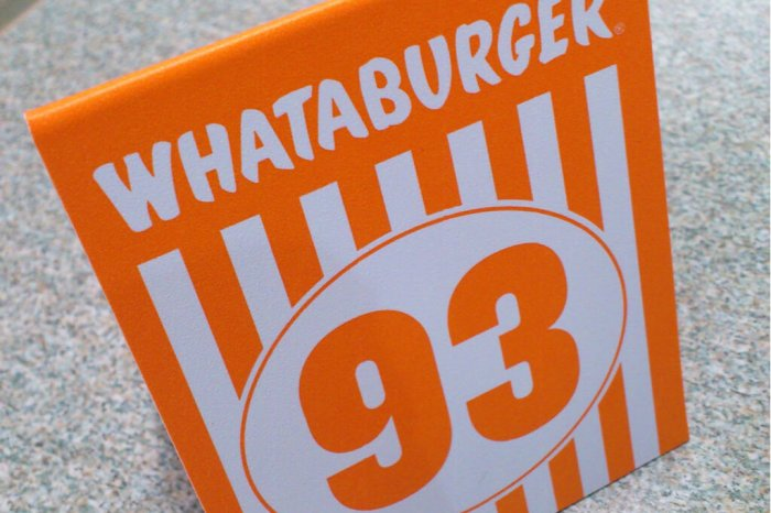 "A Whataburger placeholder for table that reads ""93""."