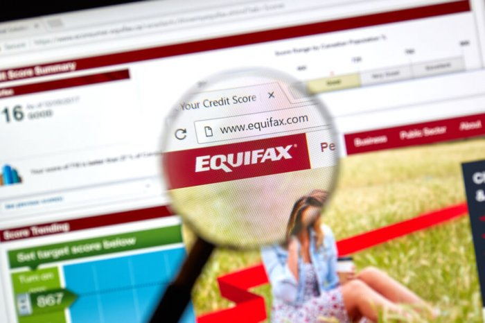 Magnifying glass over the Equifax logo