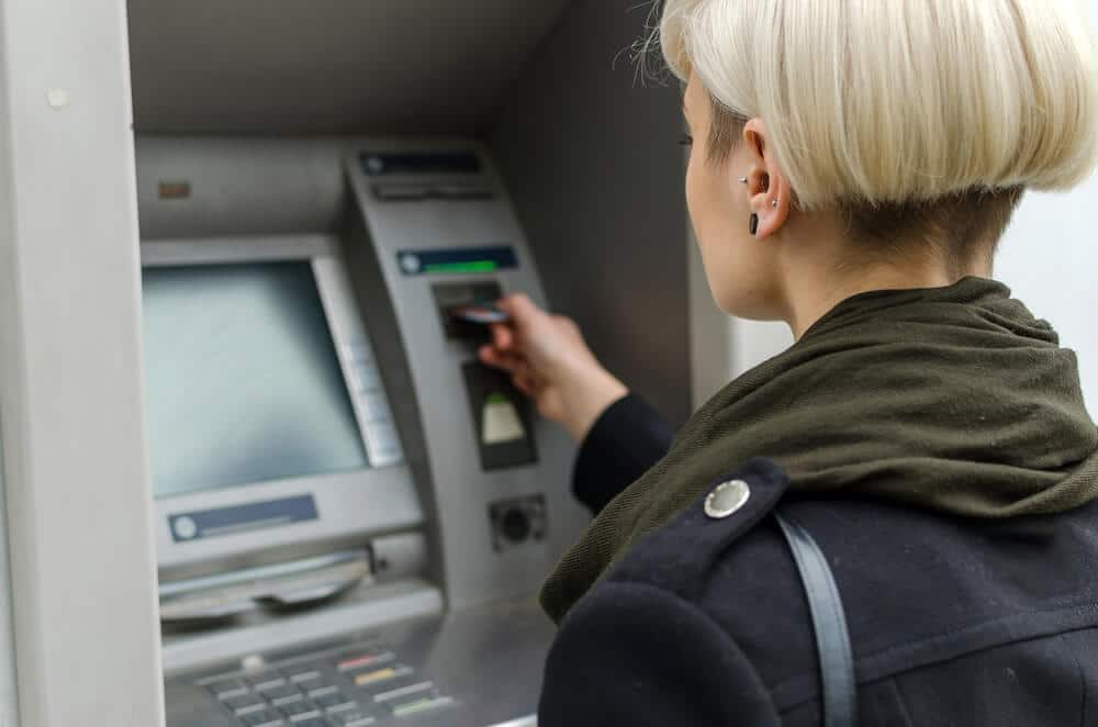Woman using her EBT card at a free ATM
