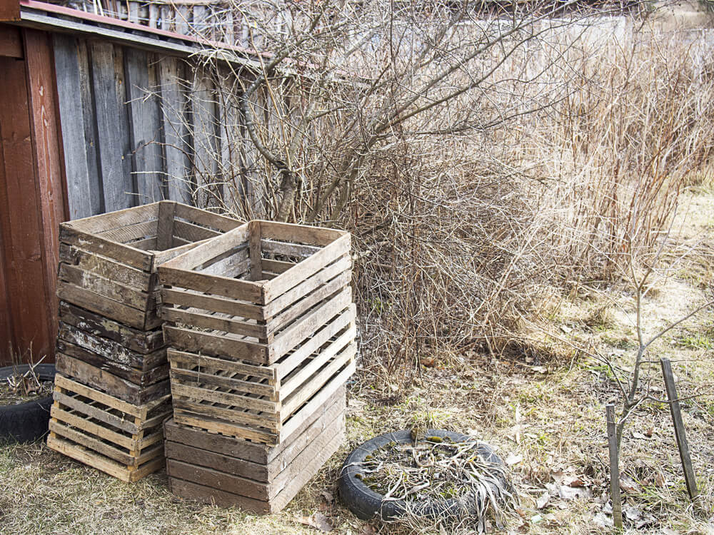 Free wooden crates sitting on a farm.