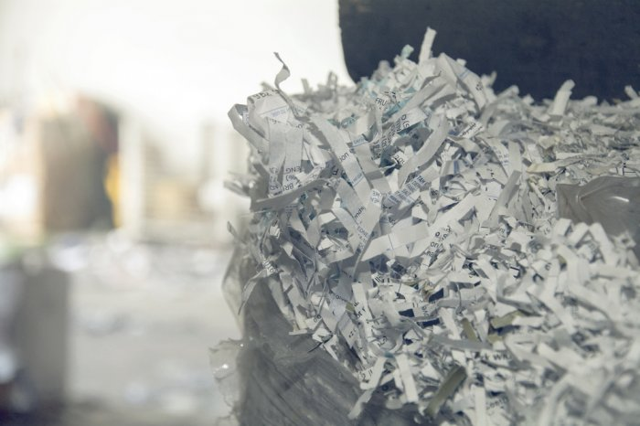 Pile of shredded paper at a document shredding facility