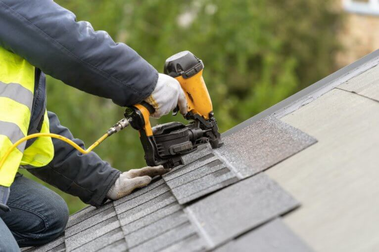 Roofer working on a house