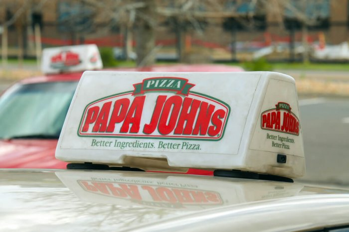 Papa John's delivery sign on a car