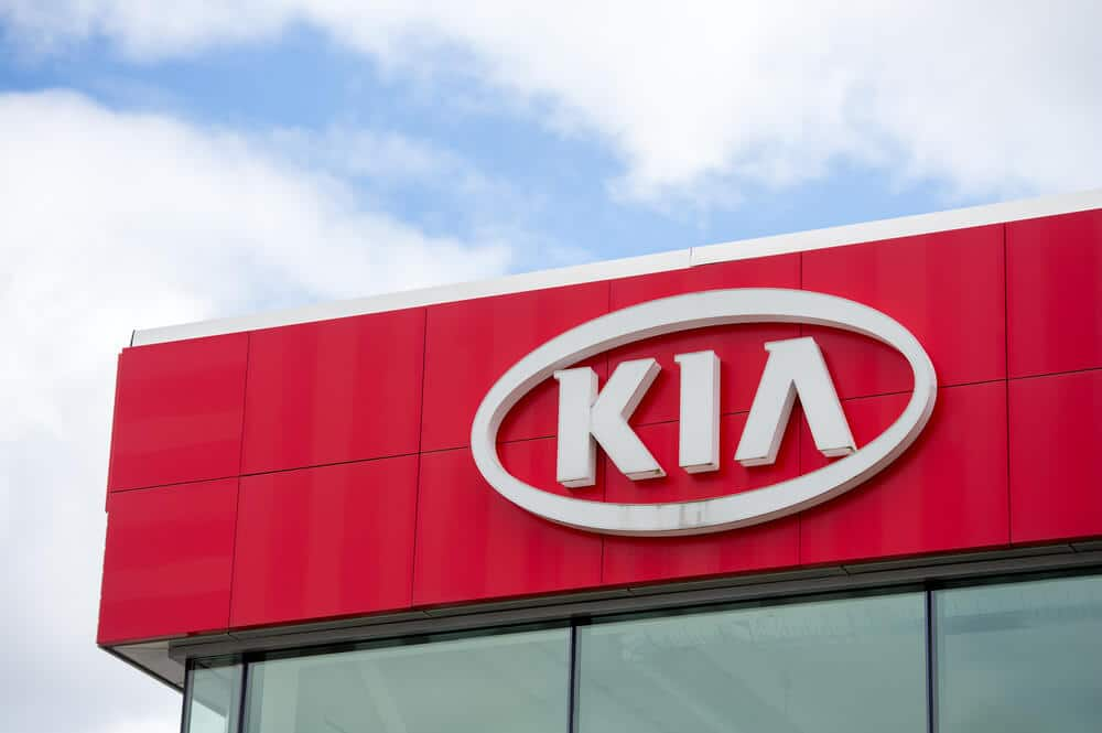 Kia logo sign on the outside of a dealership