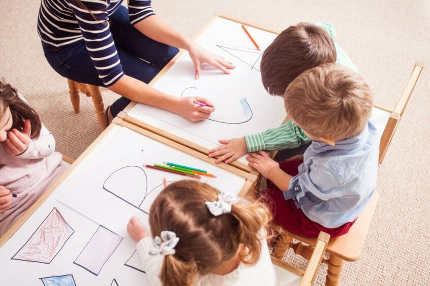 Preschoolers work on letters and shapes