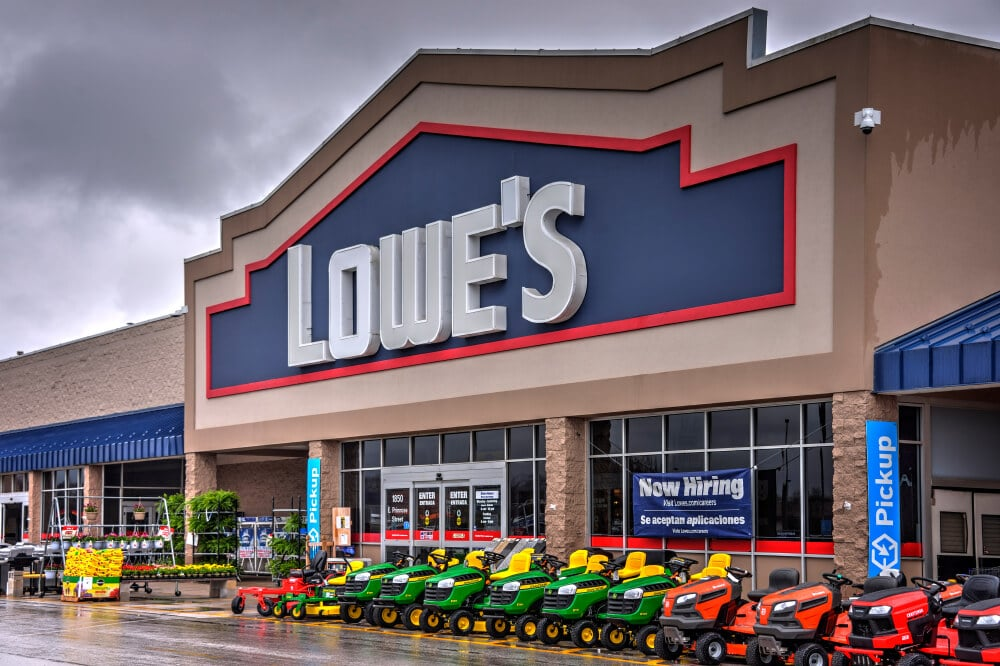 Lowe's storefront with lawn mowers out front
