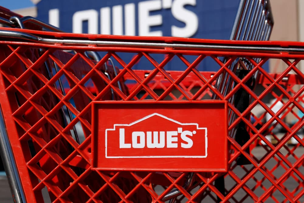 A Lowe's shopping cart outside of a Lowe's store.