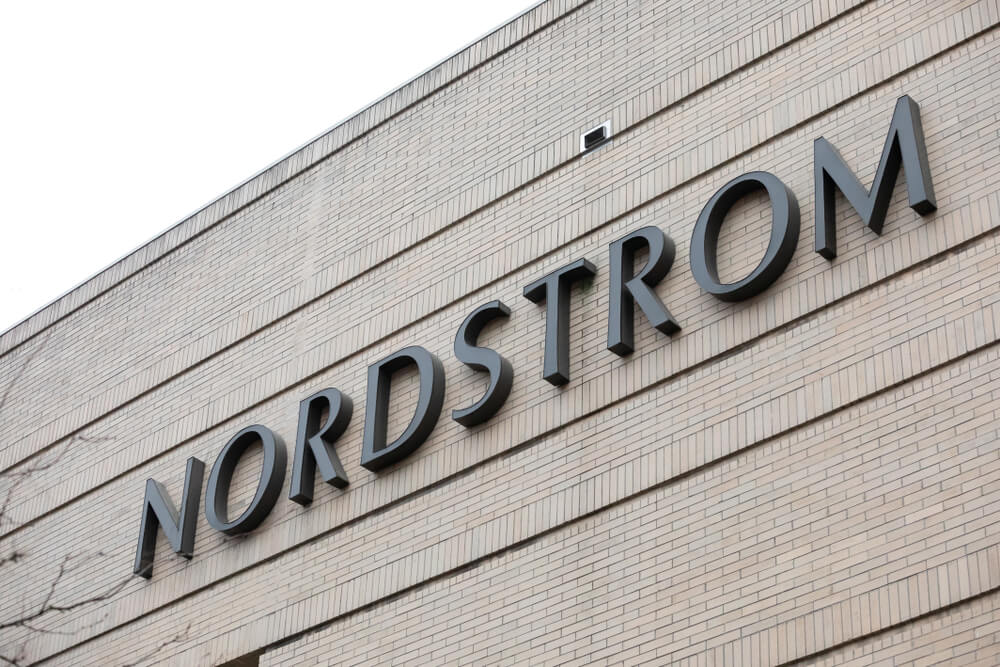 Sign on the brick exterior of a Nordstrom store