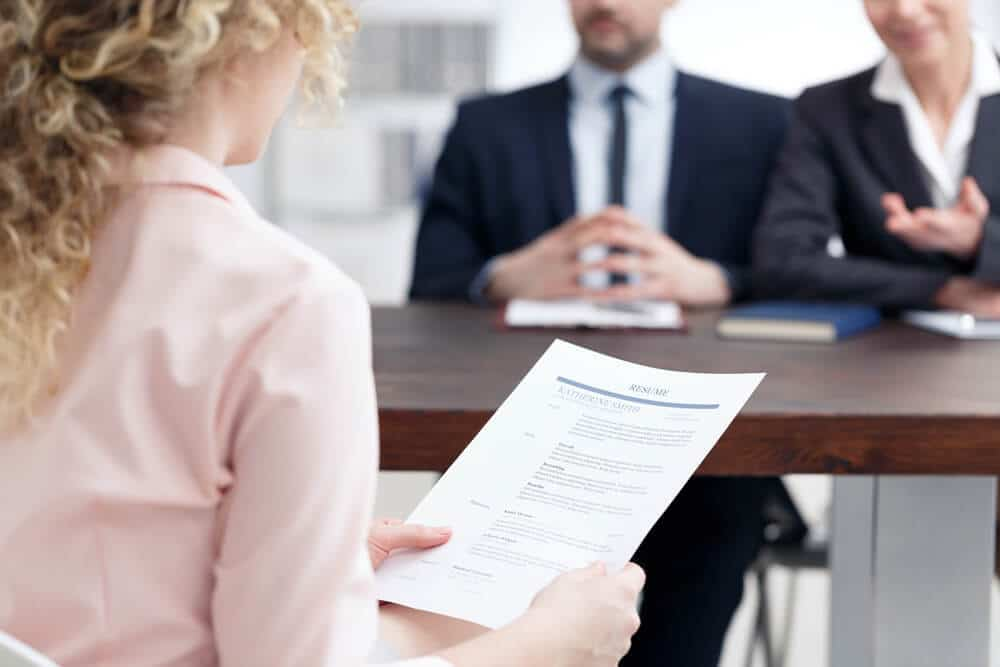 Woman discussing the personal accomplishments on her resume at a job interview