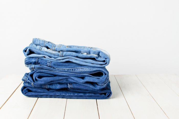 Folded jeans ready to sell to Plato's Closet