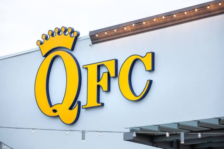 Yellow logo sign on the outside of a QFC store