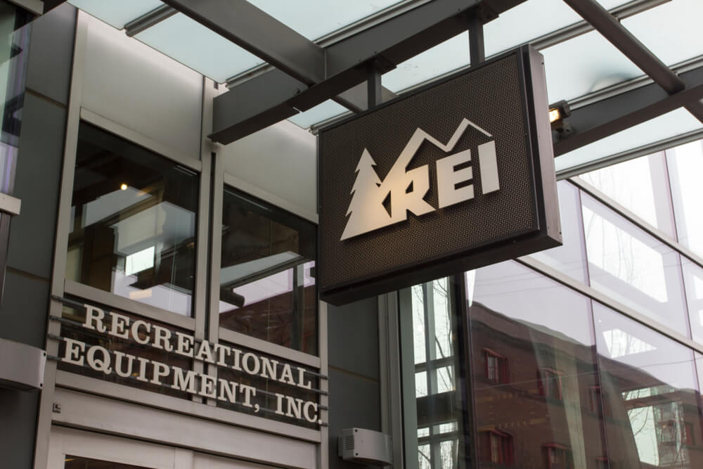 REI sign outside a store