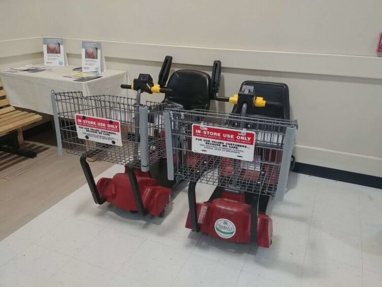 Motorized shopping cars in a grocery store.