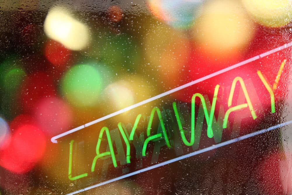 Neon layaway sign in a store window