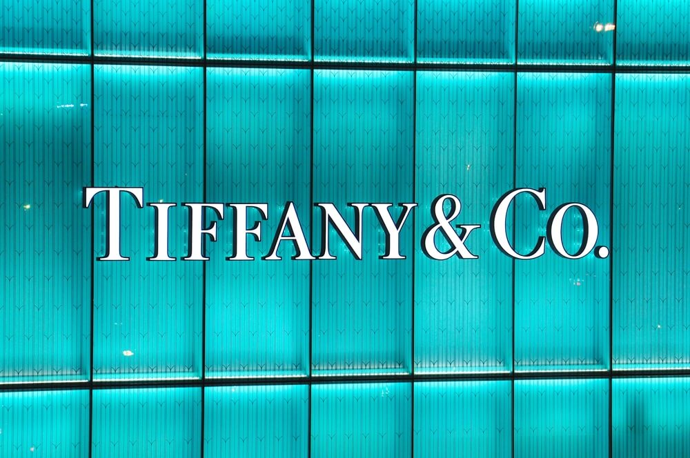 Tiffany & Co. logo on a blue wall