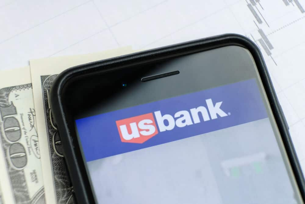 U.S. Bank logo on a phone with papers and money