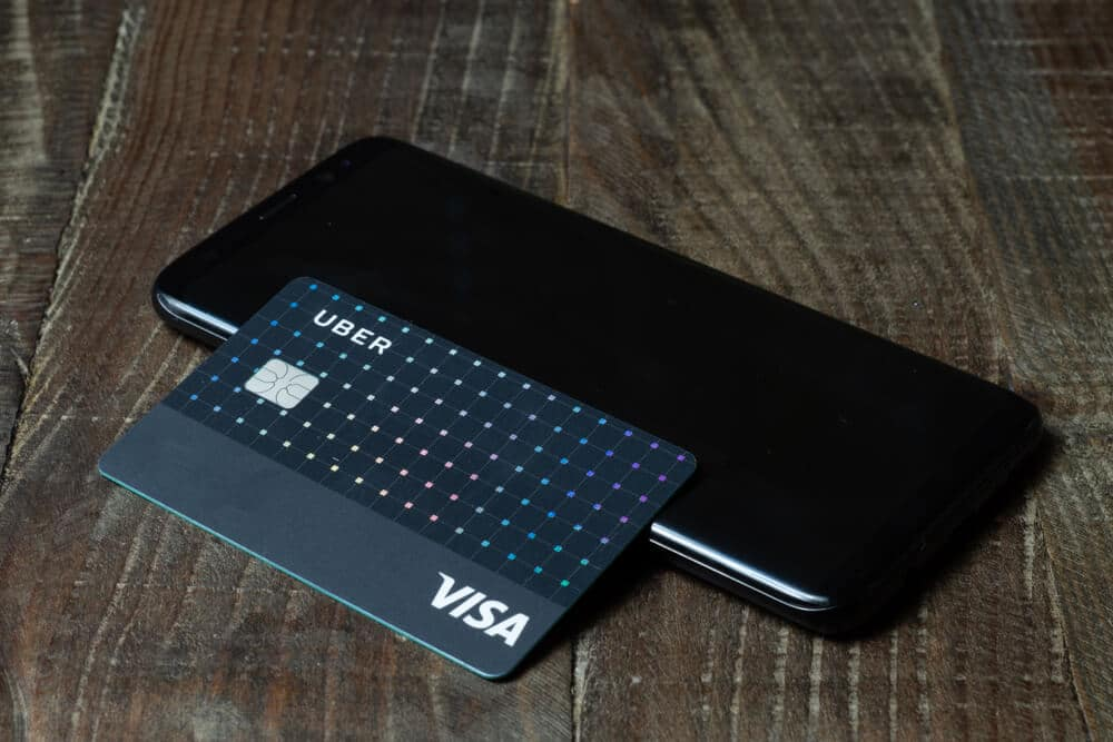 Uber credit card next to a smartphone