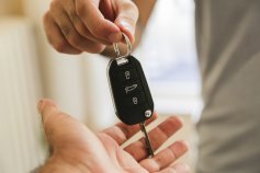 Man handing over key after voluntary car repossession