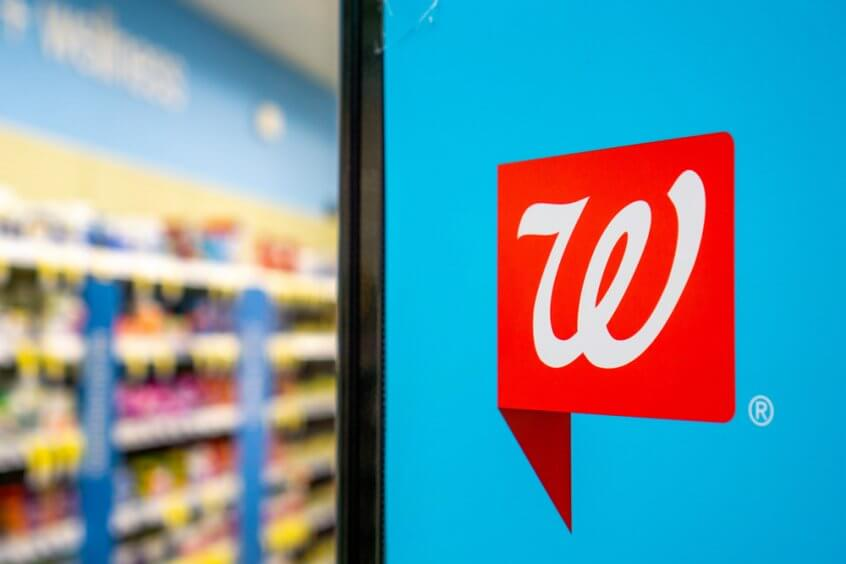 Walgreens logo on a sign in a store