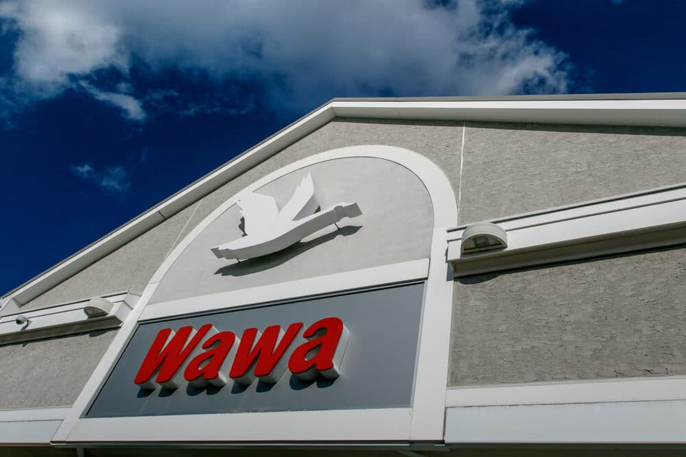 Sign above the front entrance of a Wawa store