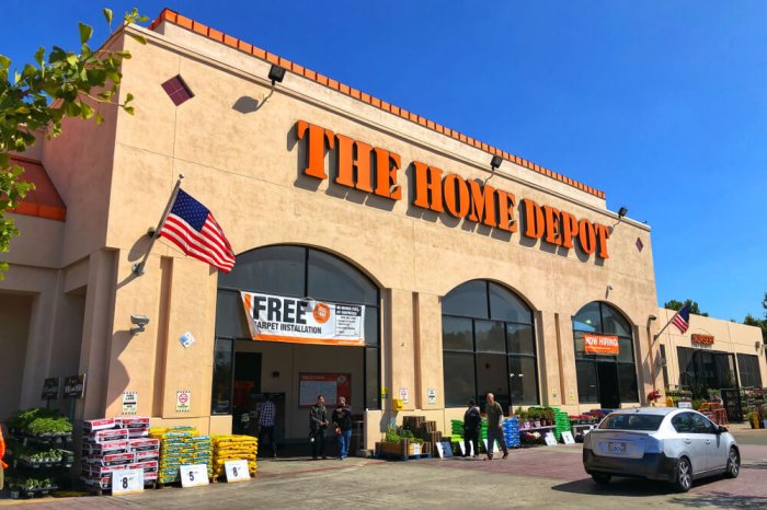 The Home Depot storefront with a bright blue sky in the background