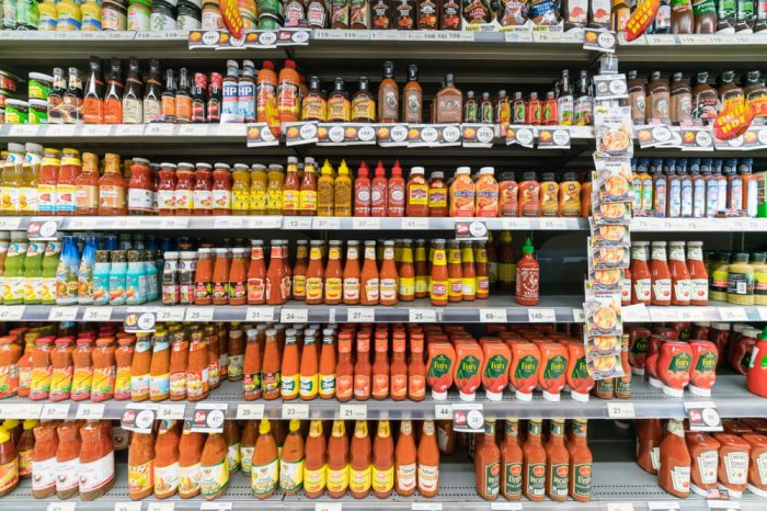 Condiments isle in grocery store where lemon juice is typically located.