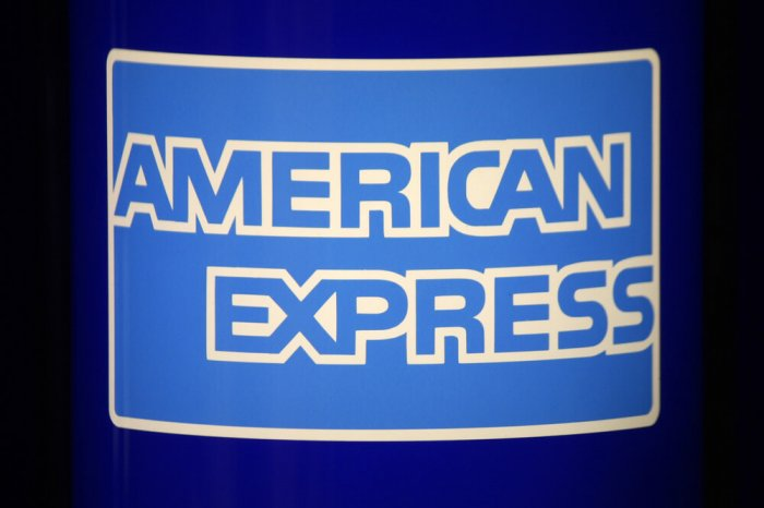 American Express sign at a location that sells travelers checks.