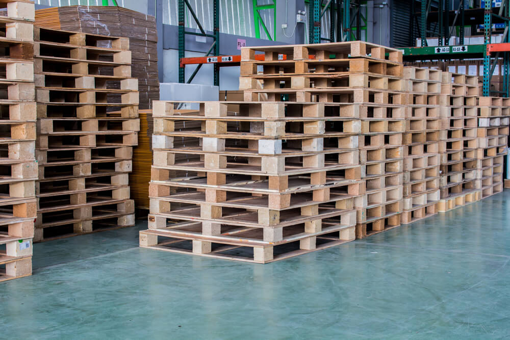 Stacks of used wood pallets at a recycling center