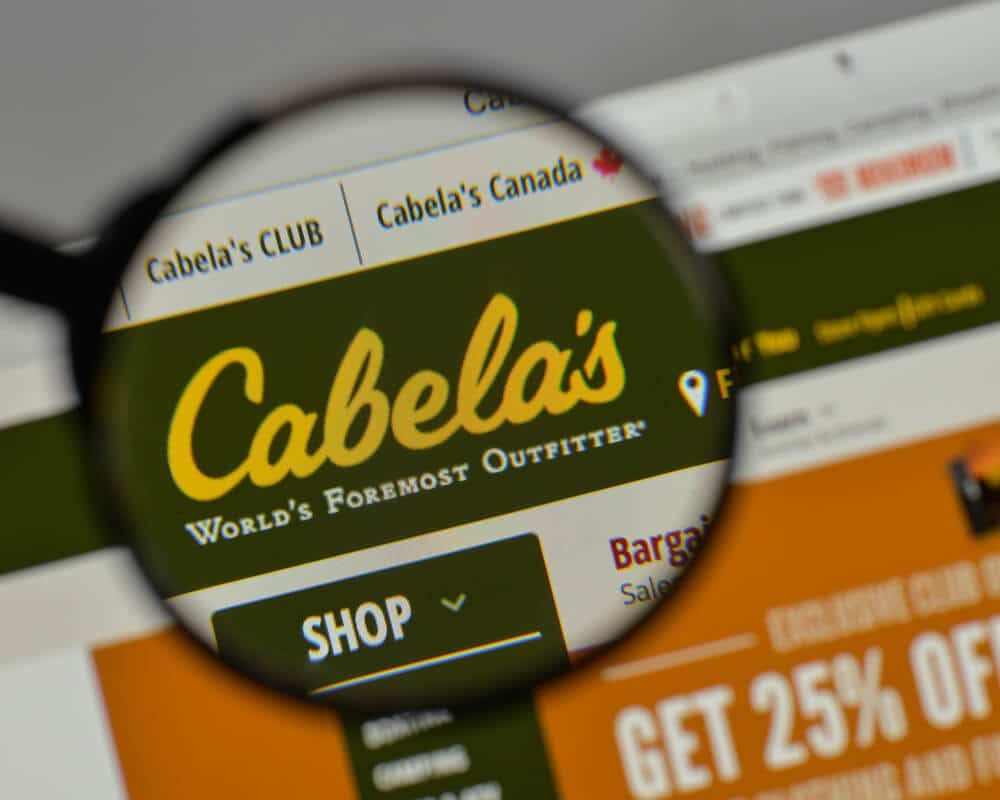 Cabela's logo under a magnifying glass.