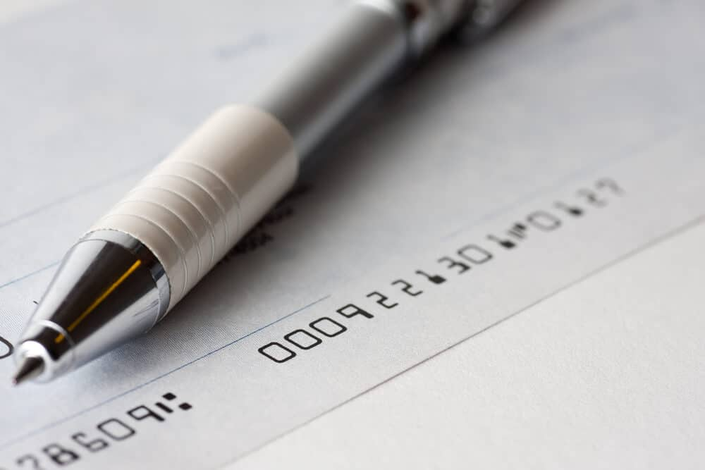 Closeup of a check and a pen