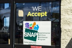 A Sign at a Retailer - We Accept SNAP II