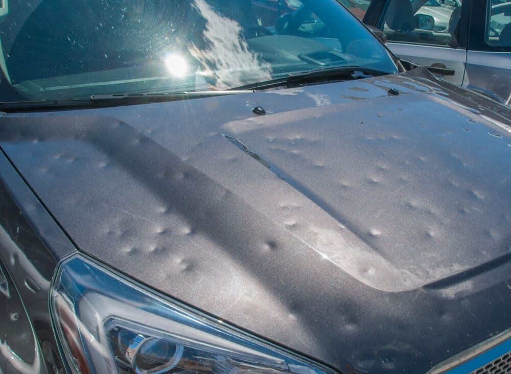 the hood of a car with hail damage