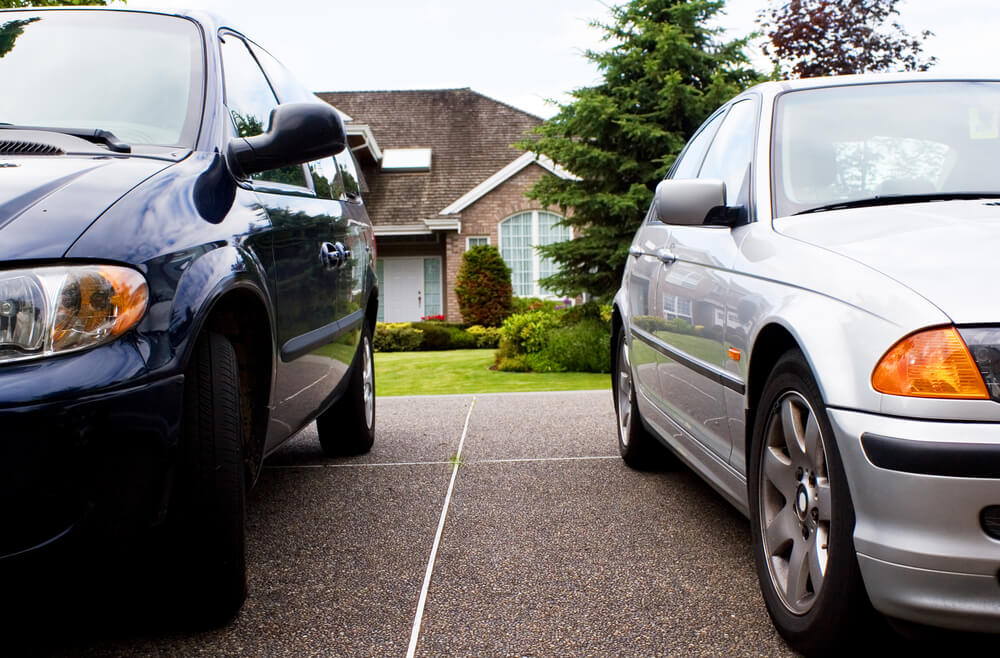 two cars in front of a house