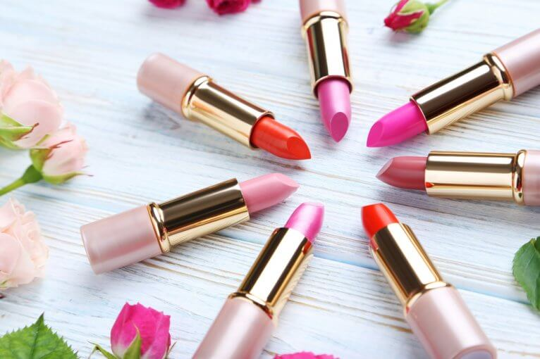 lipsticks arranged in a circle on a white table