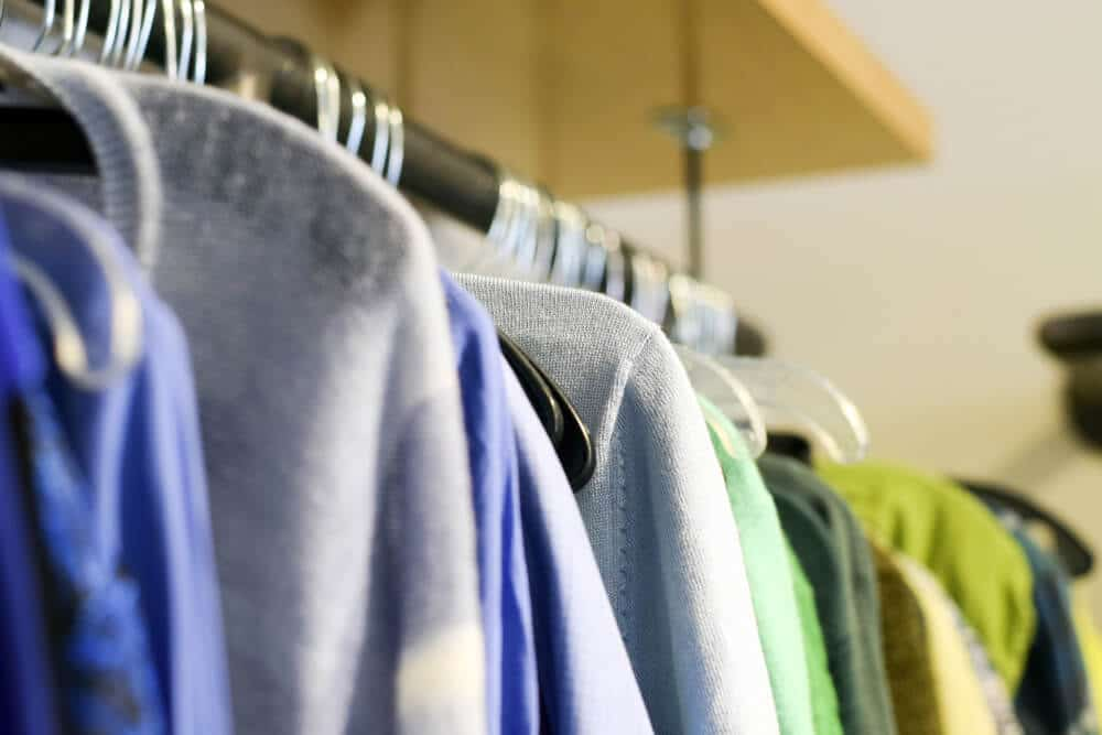 A rack of used clothing items in a store