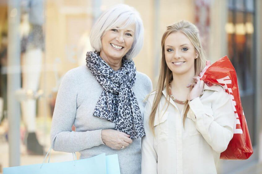 A woman and her granddaughter stand outside for this photo after shopping at HomeGoods.