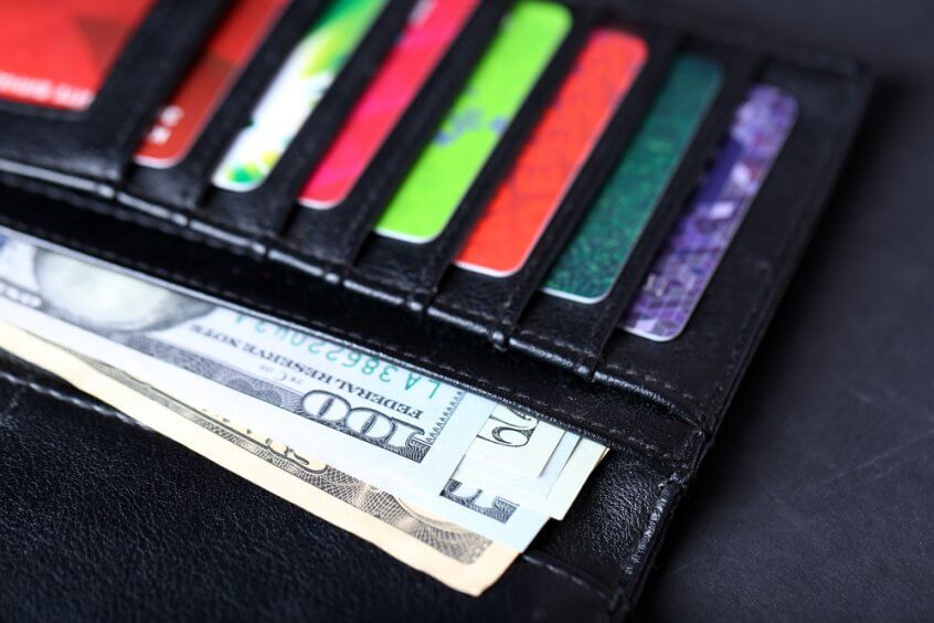 A wallet containing gift cards and cash.