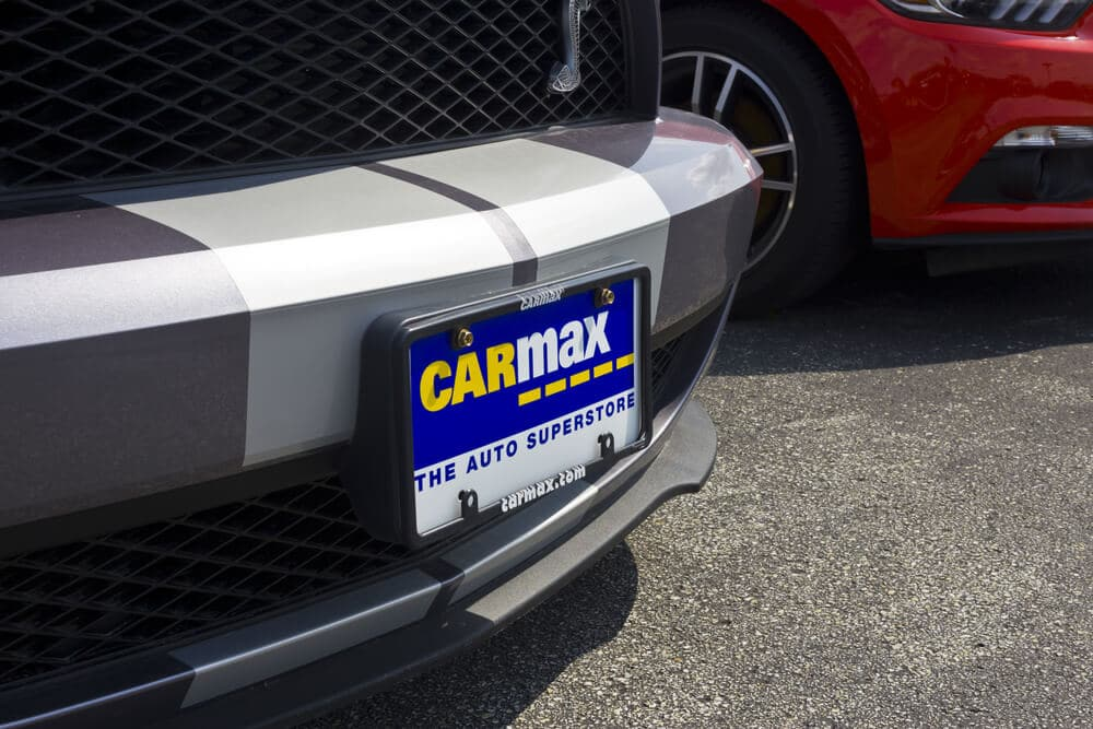 Car with a CarMax ad in license plate holder