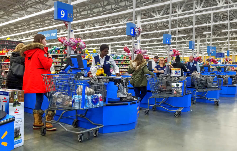 Walmart employees working at checkout