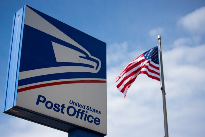 U.S. Post Office sign and American flag